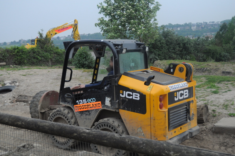 Driving a Skid Steer Loader at Diggerland when on a day out with kids