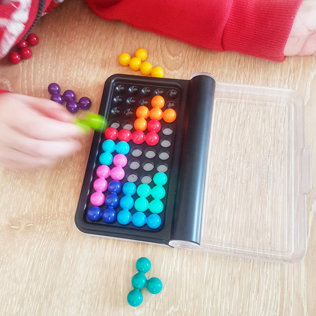 Child playing IQ Puzzler Pro - Brain Game for Kids