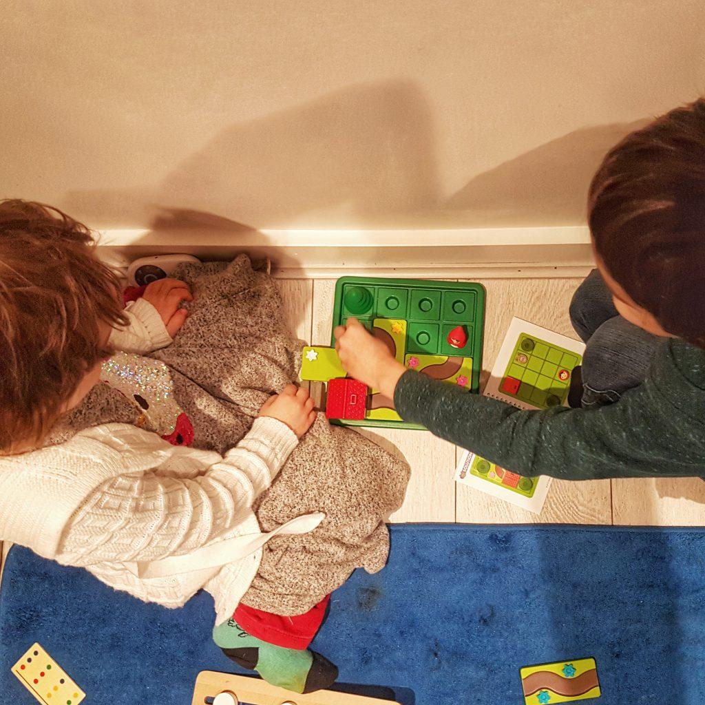 Children playing a brain teaser game