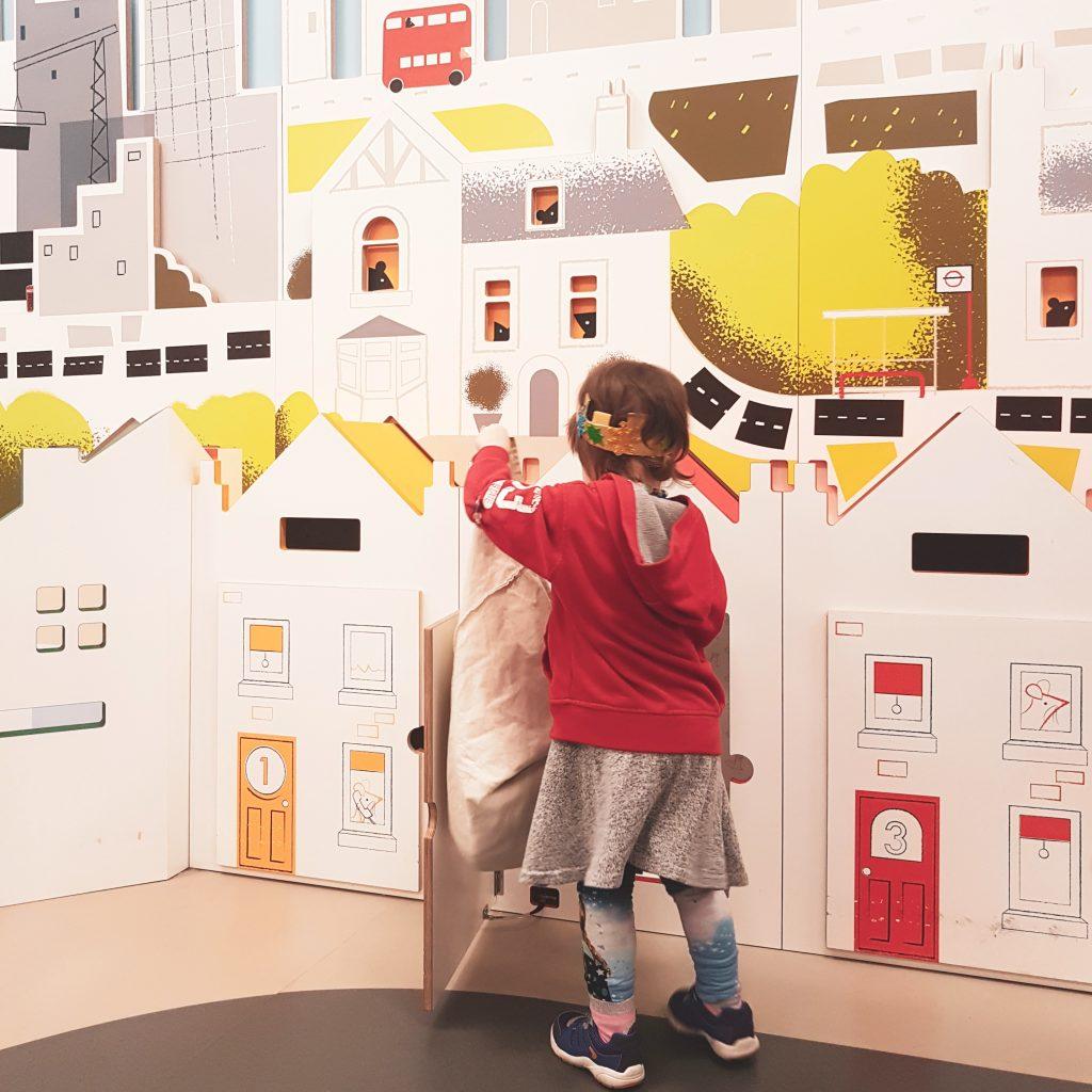 Kids being postal workers - pretend play at Postal Museum London